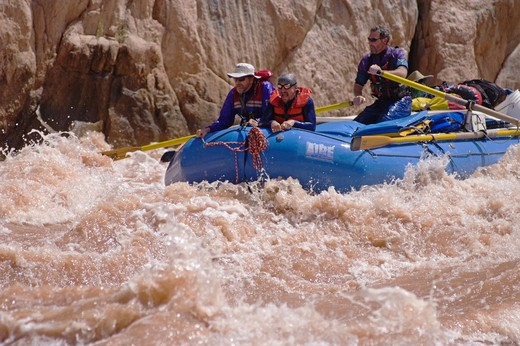 Rafters navigate GRANITE RAPID at mile 94, a Class 8 with a 17 foot drop and one of the largest on the Colorado River - GRAND CANYON, ARIZONA : Stock Photo