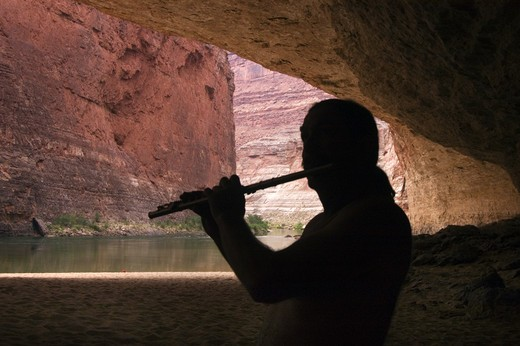 Stock Photo: 1886-51974 AMOS LOVELL plays flute in REDWALL CAVERN, a very large cave found at mile 33 along the Colorado River - GRAND CANYON,  ARIZONA