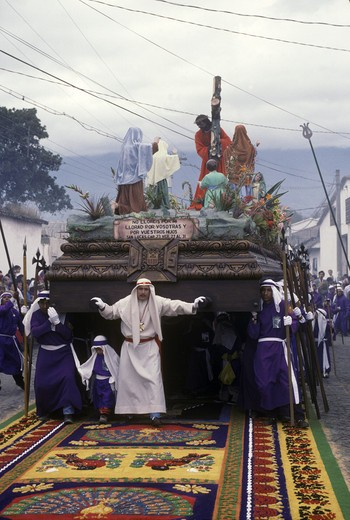Stock Photo: 1886-52010 PRIESTS and PENITENTS with ANDA (wooden float sculpted in 1650) during GOOD FRIDAY PROCESSION - ANTIGUA, GUATAMALA