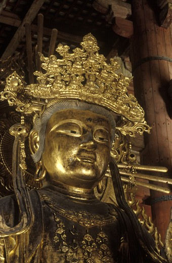 Stock Photo: 1886-52302 BUDDHIST DIETY inside TODAIJI TEMPLE, the largest wooden structure of its age in the world  - NARA, JAPAN