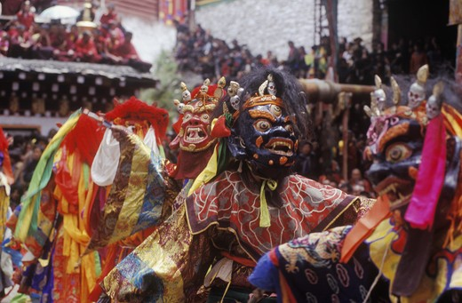 Stock Photo: 1886-52469 Masked dancers (protector deities) at the Monlam Chenmo or Cham Dances, Katok Monastery - Kham, (Tibet), Sichuan, China