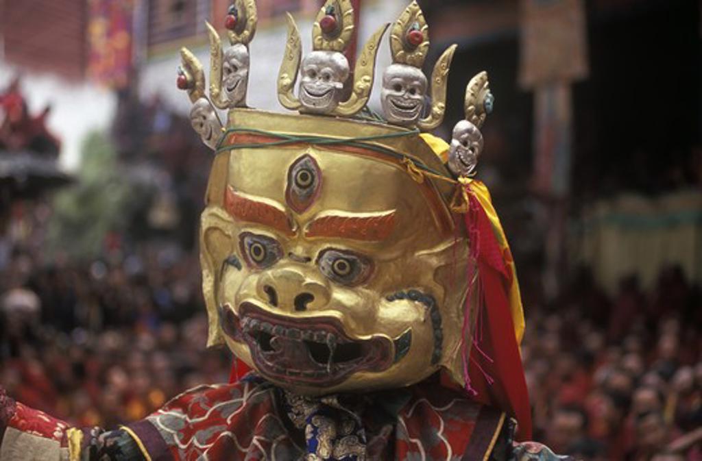 Stock Photo: 1886-52472 Masked dancer representing a Buddhist Deity at the Monlam Chenmo, Katok Monastery - Kham, (Tibet), Sichuan, China