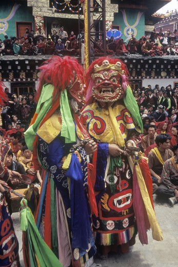 Stock Photo: 1886-52474 Masked dancers (protector deity) at the Monlam Chenmo or Cham Dances, Katok Monastery - Kham, (Tibet), Sichuan, China