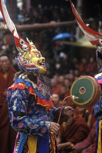 Stock Photo: 1886-52479 Masked dancer with skulls representing impermanence at the Cham dances, Katok Monastery - Kham, (Tibet), Sichuan, China