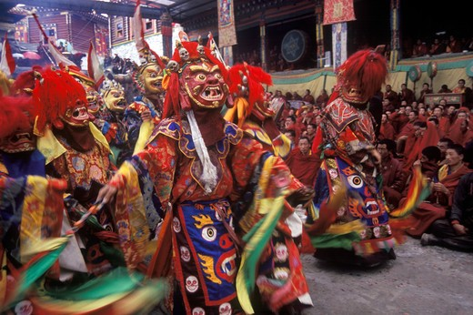 Stock Photo: 1886-52481 Masked dancer of Buddhist deity at the Monlam Chenmo or Cham Dances, Katok Monastery - Kham, (Tibet), Sichuan, China