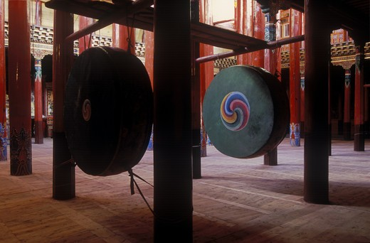 Stock Photo: 1886-52500 Pillars & drums in the reconstructed Derge Gonchen Monastery in Derge town - Kham, (E. Tibet), Sichuan Province, China