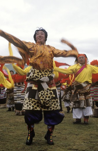 Stock Photo: 1886-52537 Dance troops preform at the Litang Horse Festival, representing various regions of Kham - Sichuan Province, China, (Tibet)