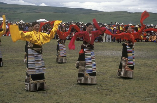Stock Photo: 1886-52540 Dance troops preform at the Litang Horse Festival, representing various regions of Kham - Sichuan Province, China, (Tibet)