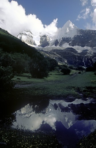 Stock Photo: 1886-52568 Reflection of Mount Chakna Dorje (5958 M),  Nyinteng (Yading) Nature Reserve, Kham - Sichuan Province, China, (Tibet)