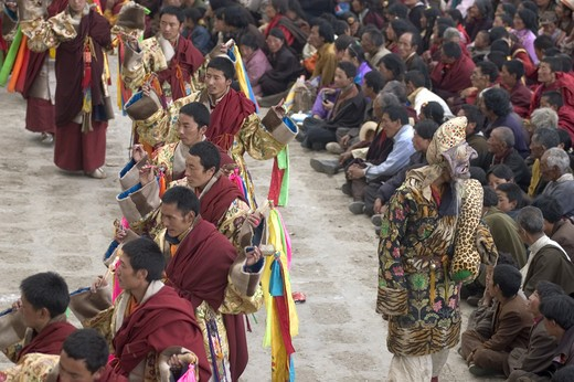 Stock Photo: 1886-52701 Monks dance with ribbons representing deity powers at the Monlam Chenmo, Katok Monastery - Kham, (Tibet), Sichuan, China