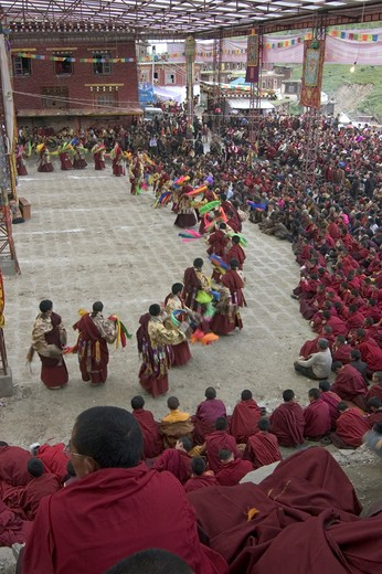 Stock Photo: 1886-52705 Monks dance with ribbons representing deity powers at the Monlam Chenmo, Katok Monastery - Kham, (Tibet), Sichuan, China