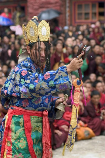 Nyingma monk with damaru drum & bell at the Cham dances, Katok Dorjeden Monastery - Kham, (Tibet), Sichuan Province, China : Stock Photo