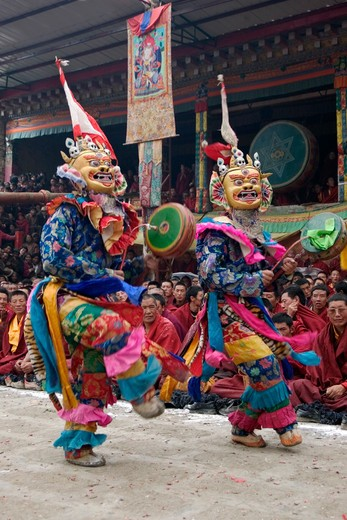 Stock Photo: 1886-52745 Masked dancers with skulls representing impermanence at the Cham dances, Katok Monastery - Kham, (Tibet), Sichuan, China