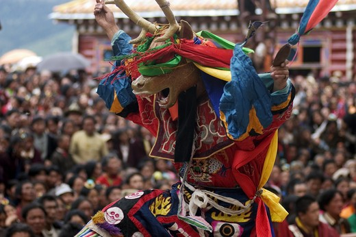 Stock Photo: 1886-52794 Deer dancer represents the animal world at the Monlam Chenpo, Katok Dorjeden Monastery - Kham, (Tibet), Sichuan, China