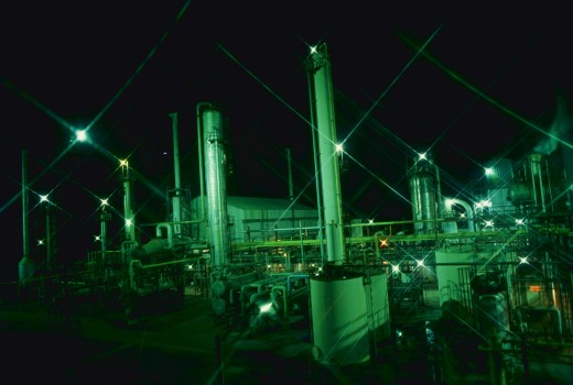 Oil refinery at night, with lights, India. : Stock Photo