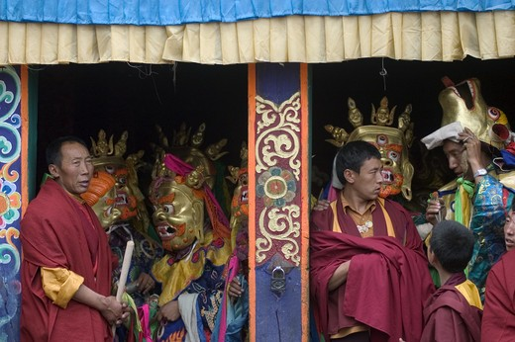Stock Photo: 1886-52801 Monk & dancers at the Monlam Chenpo, Katok Dorjeden Monastery - Kham, (eastern, Tibet), Sichuan Province, China