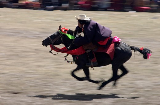 Stock Photo: 1886-52959 Khampa entertain the crowd in a rowdy horse race at the Litang Horse Festival - Kham, Sichuan Province, China, (Tibet)