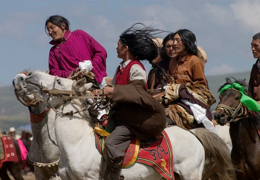 Stock Photo: 1886-52981 Khampas, the warrior horseman of old Tibet,  compete at the Litang Horse Festival - Kham, Sichuan Province, China, (Tibet)