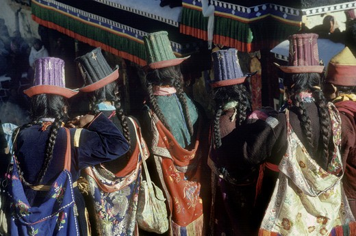 Ladakhi women wearing traditional SILK EMBROIDERED TALL HATS, TIKSE Monastery Masked Dances - LADAKH, INDIA : Stock Photo