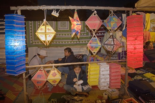 Stock Photo: 1886-53203 Laotian women sell paper lantern at the famous Night Market in the French Provincial town of LUANG PROBANG - LAOS