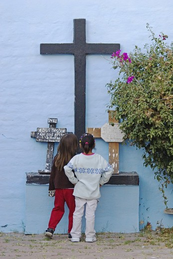Stock Photo: 1886-53526 Mexican girls examine crosses at the local cemetery during the DEAD OF THE DEAD - SAN MIGUEL DE ALLENDE, MEXICO