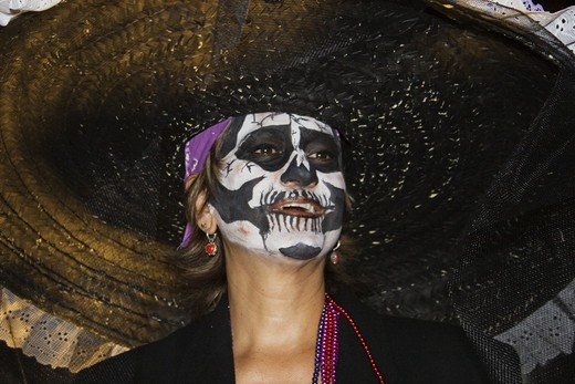 Stock Photo: 1886-53542 Adults dress up as skeletons and distribute candy to Mexican children during the DEAD OF THE DEAD - SAN MIGUEL DE ALLENDE, MEXICO