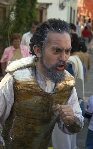 Stock Photo: 1886-53624 An actor preforms as DON QUIJOTE the mascot of the  CERVANTINO INTERNATIONAL FESTIVAL -  GUANAJUATO, MEXICO