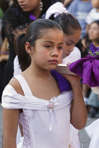 Stock Photo: 1886-53666 MEXICAN ANGEL carrying float leaves TEMPLO DEL ORATORIO DE SAN FELIPE NERI during EASTER PROCESSION - SAN MIGUEL DE ALLENDE, MEXICO