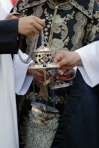 PRIESTS fill incense burner during the EASTER PROCESSION - SAN MIGUEL DE ALLENDE, MEXICO : Stock Photo