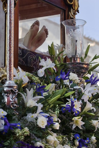 CHRIST'S FEET with flowers during the EASTER PROCESSION - SAN MIGUEL DE ALLENDE, MEXICO : Stock Photo