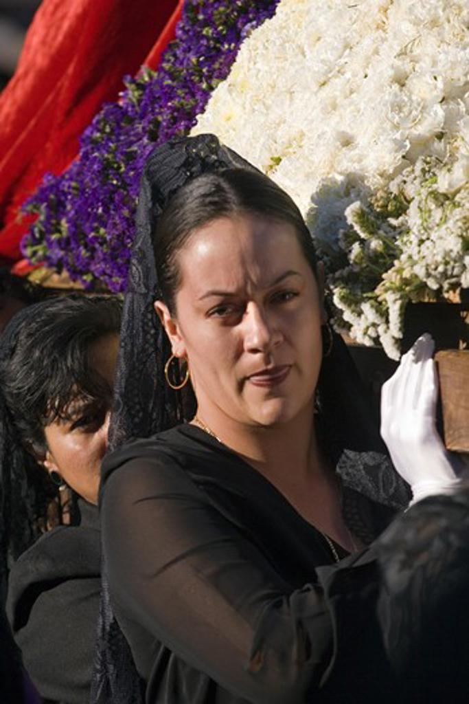 MEXICAN woman in black carries a statue during EASTER PROCESSION - TEMPLO DEL ORATORIO, SAN MIGUEL DE ALLENDE, MEXICO : Stock Photo