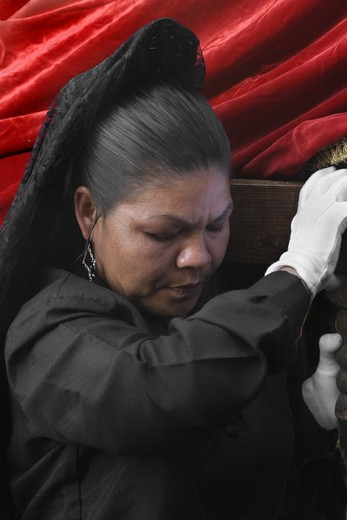 MEXICAN woman in black carries a statue during EASTER PROCESSION - TEMPLO DEL ORATORIO, SAN MIGUEL DE ALLENDE, MEXICO : Stock Photo