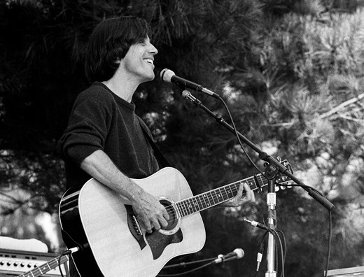 Stock Photo: 1886-53905 JACKSON BROWN sings at the Esalen Institute  during the the annual 4th of July celebration - CALIFORNIA