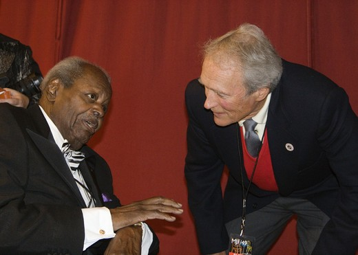 Stock Photo: 1886-53927 OSCAR PETERSON speaks while CLINT EASTWOOD listens intently backstage at THE MONTEREY JAZZ FESTIVAL