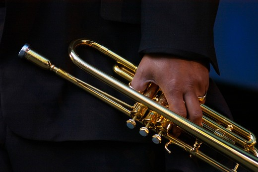 Stock Photo: 1886-53943 Trumpet in the hand of a musician at the MONTEREY JAZZ FESTIVAL - CALIFORNIA