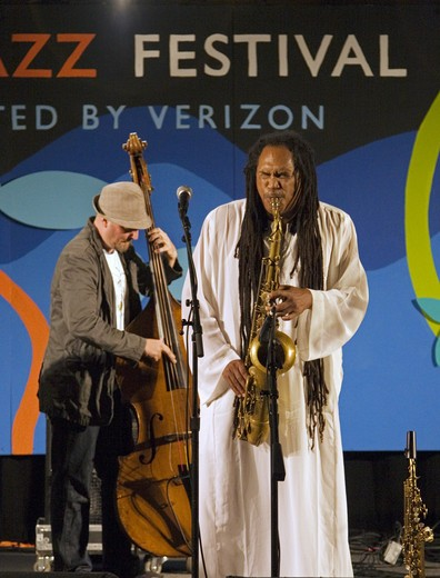 Stock Photo: 1886-54004 RICHARD HOWELL  'Tenor Saxophone', GEOFF BRENNAN  'Bass' of the BABATUNDE LEA QUARTET perform at THE MONTEREY JAZZ FESTIVAL