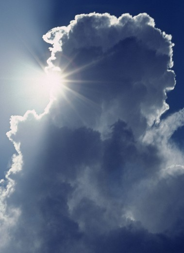 Stock Photo: 1886-54109 The SUN shines from behind a CUMULUS CLOUD as WEATHER moves over the CENTRAL VALLEY - CALIFORNIA