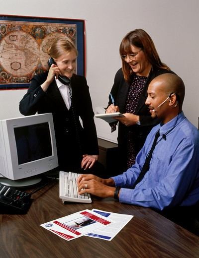 Stock Photo: 1886-54511 OFFICE WORKERS by COMPUTER - model released