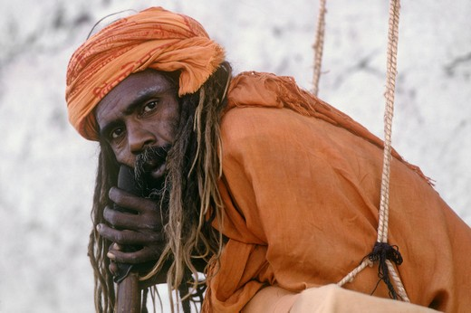 Stock Photo: 1886-54683 HINDU SADDHU in SWING with renunciate's vow to never lay on the ground at the PUSHKAR CAMEL FAIR - RAJASTHAN, INDIA