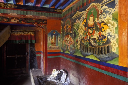 Stock Photo: 1886-55229 LING KESAR and another GAURDIAN DEITY are painted on the MONASTERY wall at the MILAREPA CAVE near NYALAM, TIBET