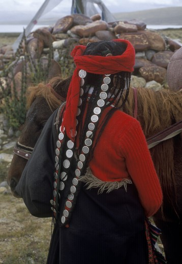 Stock Photo: 1886-55284 TIBETAN WOMAN with antique COIN HAIR PIECE at LAKE MANASAROVAR (4550M), BUDDHIST & HINDU site - KAILASH, TIBET