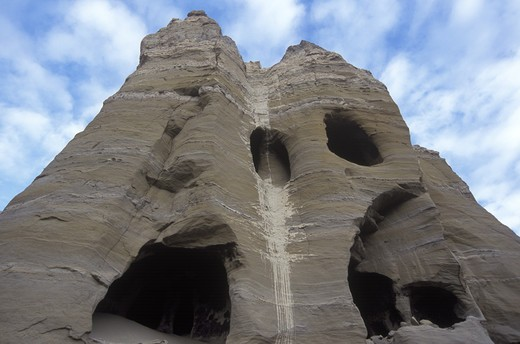Multilevel CAVE DWELLINGS near THOLING date back to the 10th C. in the GUGE KINGDOM west of KAILASH - TIBET : Stock Photo