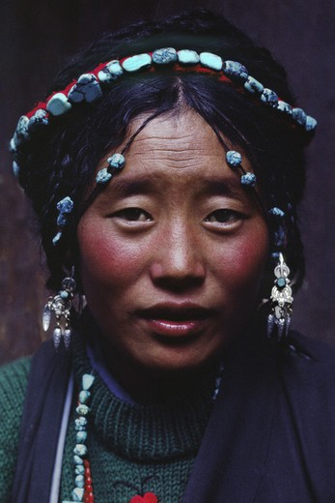 Tibetan beauty with elaborate tourquoise headdress - Barkhor,Lhasa. : Stock Photo