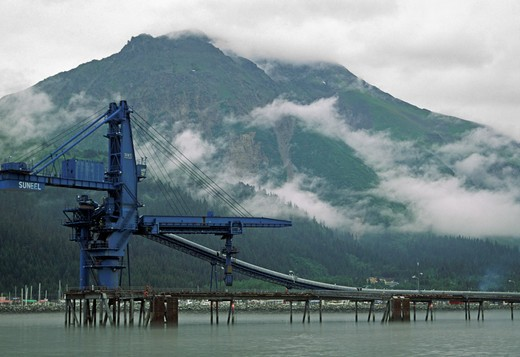 CARGO LIFT poised above the still water of SEWARD HARBOR - ALASKA : Stock Photo