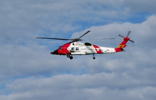 Stock Photo: 1886-55714 US COASTGUARD HELICOPTER over Glacier Bay - ALASKA
