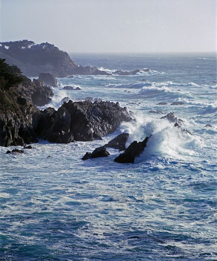 Stock Photo: 1886-5577 A large PACIFIC WAVE smashes against the rocks at GARAPATA STATE BEACH - MONTEREY BAY SANCTUARY, CALIFORNIA