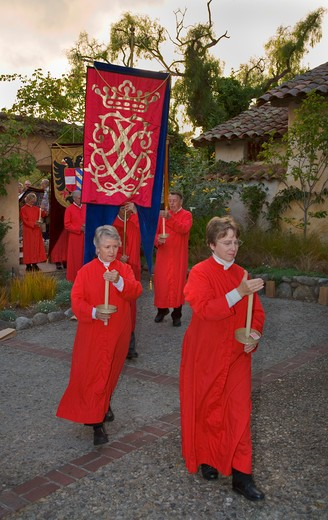 Church members carry banners  reenacting the MEDIEVAL TRADITION during the CARMEL BACH FESTIVAL - CARMEL MISSION,  CALIFORNIA : Stock Photo
