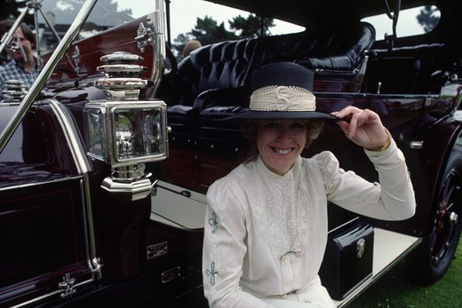 Owner in costume with 1909 WELCH MODEL 4-0 CLOSE COUPLED TOURING CAR at the CONCOURSE D'ELEGANCE - PEBBLE BEACH, CALIFORNIA : Stock Photo