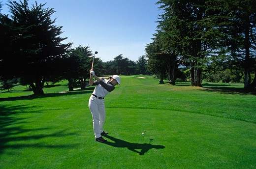 TEEING OFF with a DRIVER on the SECOND HOLE of BAYONETTE GOLF COURSE at Fort Ord on the MONTEREY PENINSULA - CALIFORNIA : Stock Photo