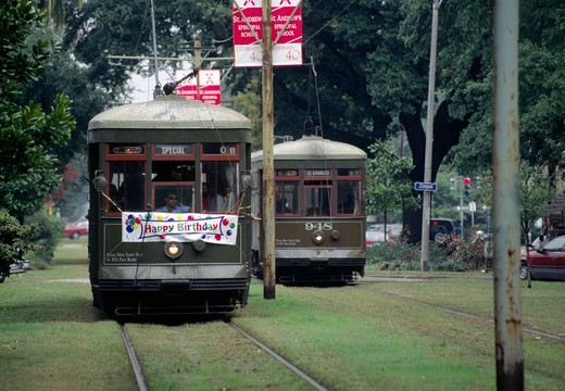 Stock Photo: 1886-56178 TROLLEY CARS pass on ST. CHARLES AVE - NEW ORLEANS, LOUISIANA